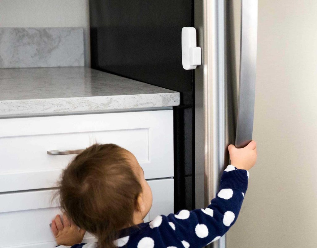 Image of child trying to open the fridge
